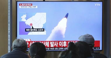 People watch a TV showing file footage of North Korea's missile launch during a news program at the Seoul Railway Station in Seoul, South Korea, Thursday, May 9, 2019.