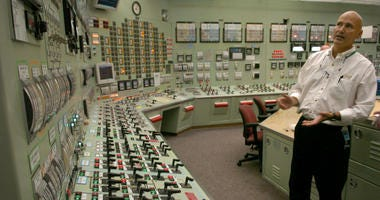 Reactor operator Chris Mitchell explains the control room at the Oyster Creek Nuclear Power Plant in Lacey, New Jersey, the oldest nuclear plant in the country, in 2004.