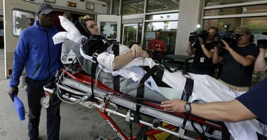 In this May 31, 2018, file photo, Ryan Straschnitzki is wheeled on a stretcher into Shriners Hospitals for Children in Philadelphia.