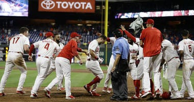 Philadelphia Phillies' Trevor Plouffe, second from right, celebrates with teammates.