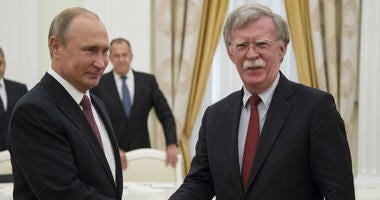 Russian President Vladimir Putin, left, shakes hands with U.S. National security adviser John Bolton during their meeting in the Kremlin in Moscow, Russia, Wednesday, June 27, 2018.