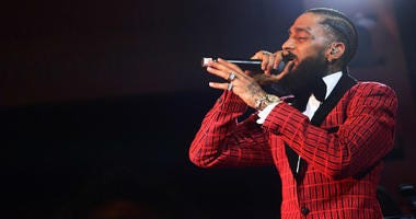 Eric Holder, the suspect in the fatal shooting of Grammy-nominated rapper Nipsey Hussle, was charged Thursday with murder and two counts of attempted murder, authorities said.