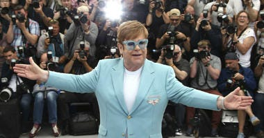Elton John poses for photographers at the photo call for the film 'Rocketman' at the 72nd international film festival, Cannes, southern France, Thursday, May 16, 2019.