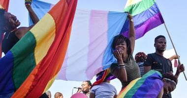 Dozens of people cheer and dance as they take part in the Namibian Lesbians, Gay, Bisexual and Transexual (LGBT) community pride Parade in the streets of the Namibian Capitol on July 29, 2017 in Windhoek.