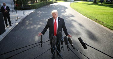 President Donald Trump plans to threaten to impose new tariffs on Mexico if the country does not step up its enforcement actions, a senior administration official said on Thursday.