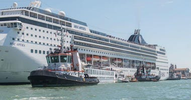 The damaged tourist river boat docked next to the cruise ship after Sunday's collision.