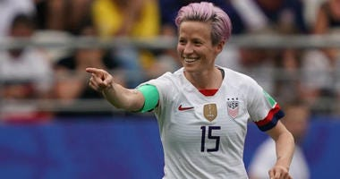 It wasn't easy, and at times there was doubt, but defending champion the US can look ahead to a mouthwatering quarterfinal clash against host France after a 2-1 win over a resolute Spain.