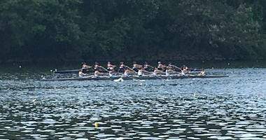 A crew team rows on the Schuylkill River.