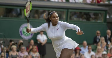Serena Williams (USA) in action during her match against Angelique Kerber (GER) on day 12 at All England Lawn and Croquet Club.