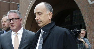 California businessman Stephen Semprevivo departs federal court Tuesday, May 7, 2019, in Boston, after pleading guilty to charges that he bribed the Georgetown tennis coach to get his son admitted to the school.