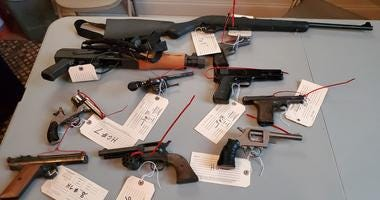 Guns collected at Taylor Memorial Baptist Church as part of a giveback event.