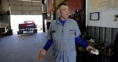 In this Wednesday, Jan. 23, 2019, photo, mechanic Terry Rose talks about the government shutdown at his business in Fort Hancock, Texas.