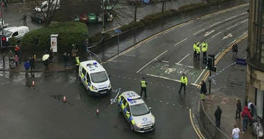 The scene as police secure the area outside the University of Glasgow, Scotland, after a suspicious package was found the university, Wednesday March 6, 2019.