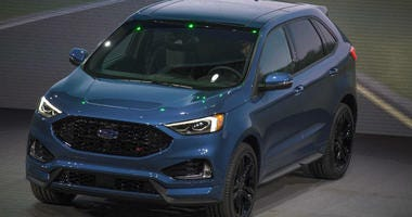Jan 14, 2018; Detroit, MI, USA; Ford reveals the 2019 Edge ST during the North American International Auto Show at Detroit's Cobo Center.