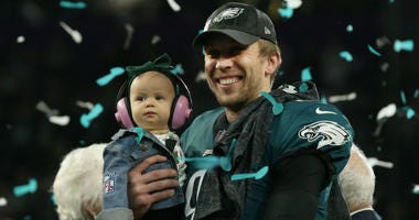 Feb 4, 2018; Minneapolis, MN, USA; Philadelphia Eagles quarterback Nick Foles (9) holds his daughter Lily while on the podium after a victory against the New England Patriots in Super Bowl LII at U.S. Bank Stadium.
