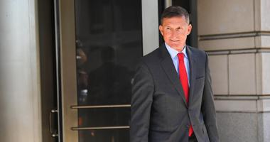 Former national security adviser Michael Flynn departs following a court appearance.