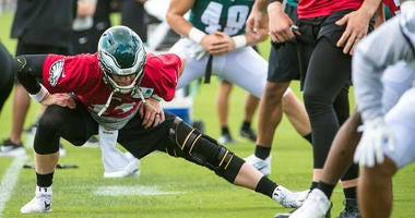 Philadelphia Eagles quarterback Carson Wentz does warm up drills with his teammates during training camp at the NovaCare Complex.