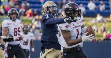 Oct 13, 2018; Annapolis, MD, USA; Temple Owls wide receiver Ventell Bryant (1) makes a catch against Navy Midshipmen cornerback Cameron Kinley (3) during the second half at Navy-Marine Corps Memorial Stadium.