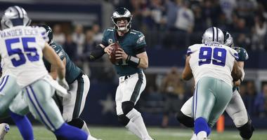 Dec 9, 2018: Philadelphia Eagles quarterback Carson Wentz looks to pass in the fourth quarter against the Dallas Cowboys at AT&T Stadium.