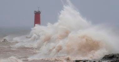 Strong winds whipped waves against the Sheboygan north pier breakwater, Saturday, April 14, 2018, in Sheboygan, Wis.