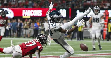 Philadelphia Eagles wide receiver Nelson Agholor (13) has a catch broken up by Atlanta Falcons free safety Ricardo Allen (37) in the second quarter at Mercedes-Benz Stadium.
