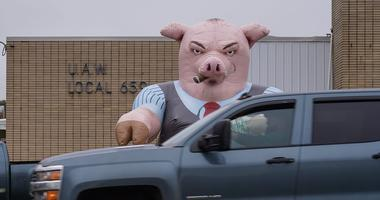 An inflatable pig sits outside of UAW Local 659 in Flint on Thursday, October 3, 2019.