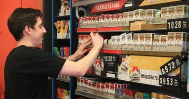 Sales clerk Jimmy Canzoneri stocks the shelves at Smokes 4 Less smoke shop in the village of Wappingers Falls on November 12, 2019.