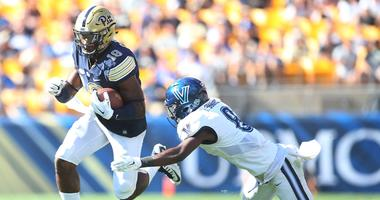 Pittsburgh Panthers wide receiver Dontez Ford runs after a pass reception against Villanova Wildcats defensive back Trey Johnson. Johnson sued the NCAA Wednesday over student athlete pay.