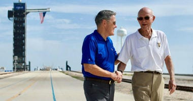 In this Tuesday, July 16, 2019 photo made available by NASA, astronaut Michael Collins, right, speaks to Kennedy Space Center Director Bob Cabana at Launch Complex 39A, about the moments leading up to launch at 9:32 a.m. on July 16, 1969, and what it was