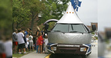 Youngsters line up to see the Hershey's Kissmobile during its stop in Berlin, Vt.