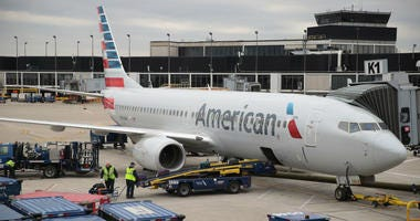 Workers load luggage onto an American Airlines aricraft at O'Hare International Airport on May 11, 2018 in Chicago, Illinois. Today American Airlines held a ceremony to mark the opening of five new gate at the airport.