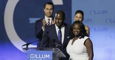 Florida gubernatorial Democratic candidate Andrew Gillum gives his concession speech with his wife R. Jai Gillum, running mate Chris King, and his wife Kristen King at Florida A&M University in Tallahassee on Tuesday, Nov. 6, 2018.