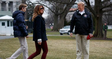 In this March 8, 2019 file photo, President Donald Trump waits for his son Barron Trump, and first lady Melania Trump after speaking with reporters before traveling to Alabama to visit areas affected by the deadly tornadoes.