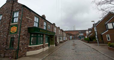 FILE - In this file photo dated Friday, Nov. 29, 2013, the film set of long running British soap opera entitled 'Coronation Street', in Manchester, England. The long running TV series covering an intimate look into the lives of families in the fictional n