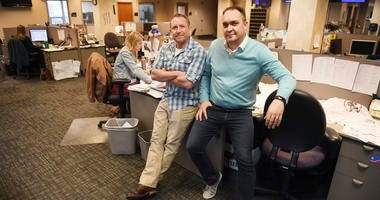In this April 9, 2019, photo, Argus Leader investigative reporter Jonathan Ellis and news director Cory Myers in the newsroom in Sioux Falls, S.D. In 2010, reporters at South Dakota's Argus Leader newspaper came up with the idea of requesting data about