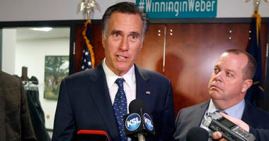 FILE - In this Friday Jan., 18, 2019 file photo, Utah Sen. Mitt Romney, left, speaks with reporters after visiting with local officials to discuss how the four-week partial government shutdown is impacting an area with several major federal employers, in