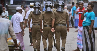 Sri Lankan policeman patrol in a Muslim neighborhood before Friday prayers in Colombo, Sri Lanka, Friday, April 26, 2019. Across Colombo, there was a visible increase of security as authorities warned of another attack and pursued suspects that could have