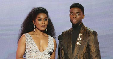 """Angela Bassett, left, and Chadwick Boseman, nominated for outstanding performance by a cast in a motion picture, introduce a clip from their film """"Black Panther"""" at the 25th annual Screen Actors Guild Awards at the Shrine Auditorium & Expo Hall in L.A."""