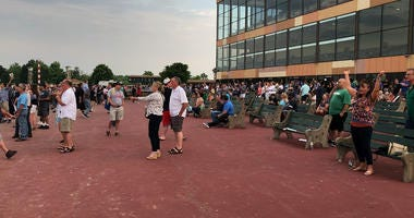Crowds outside Parx Racing watching the end of the Belmont Stakes