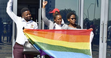 Activists celebrate outside the High Court in Gaborone, Botswana, Tuesday June 11, 2019.