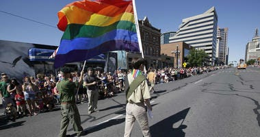 a group of Boy Scouts march during Salt Lake City's annual gay pride parade