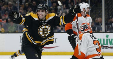 Boston Bruins' Jake DeBrusk (74) celebrates his goal against Philadelphia Flyers' Brian Elliott (37) during the second period of an NHL hockey game in Boston, Thursday, Oct. 25, 2018.