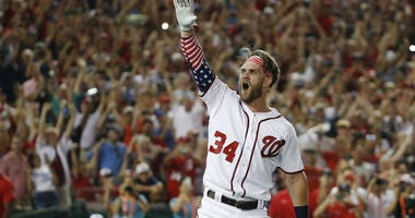 In this July 16, 2018, file photo, Washington Nationals Bryce Harper (34) reacts to his winning hit during the Major League Baseball Home Run Derby, in Washington.