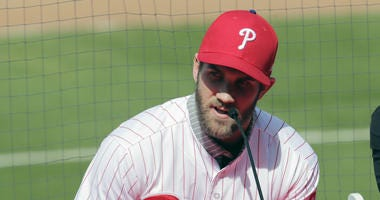 In this Saturday, March 2, 2019 file photo, Bryce Harper speaks during a news conference at the Philadelphia Phillies spring training baseball facility in Clearwater, Fla.