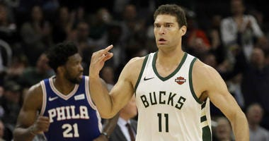Milwaukee Bucks' Brook Lopez (11) reacts after making a three point basket during the first half of an NBA basketball game against the Philadelphia 76ers Wednesday, Oct. 24, 2018, in Milwaukee.
