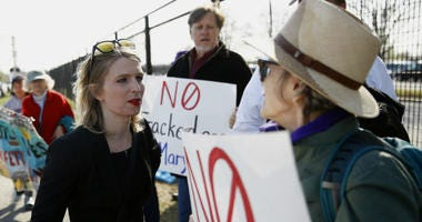 Chelsea Manning speaks with protesters at an anti-fracking rally in Baltimore