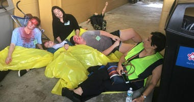 Widener nursing students act as victims in an emergency drill.