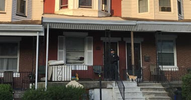 Philadelphia police say a man smashed the front window of this house, took his ex's 2-year-old girl and drove off in her car.