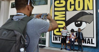 Luis Ramos of San Diego takes a picture of his son, daughter and  friends before Preview Night at the 2018 Comic-Con International at the San Diego Convention Center, Wednesday, July 18, 2018, in San Diego.