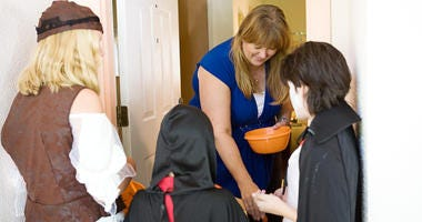 Giving out candy on Halloween can be more of a chore than you imagined.